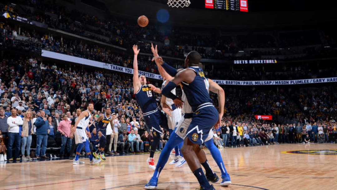 DENVER, CO - MARCH 14: Nikola Jokic #15 of the Denver Nuggets makes the game winning shot against the Dallas Mavericks on March 14, 2019 at the Pepsi Center in Denver, Colorado. NOTE TO USER: User expressly acknowledges and agrees that, by downloading and/or using this photograph, user is consenting to the terms and conditions of the Getty Images License Agreement. Mandatory Copyright Notice: Copyright 2019 NBAE (Photo by Bart Young/NBAE via Getty Images)