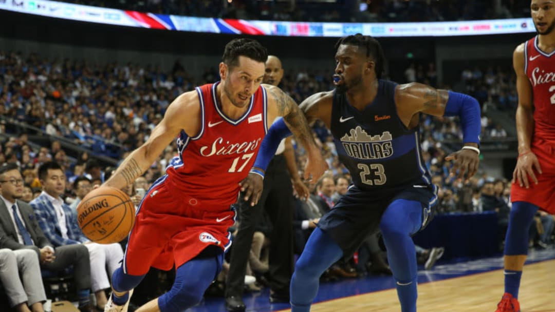 In this photo taken on October 5, 2018, JJ Reddick (L) of the Philadelphia 76ers drives past Wesley Matthews of the Dallas Mavericks during their preseason NBA basketball game in Shanghai. (Photo by STR / AFP) / China OUT (Photo credit should read STR/AFP/Getty Images)