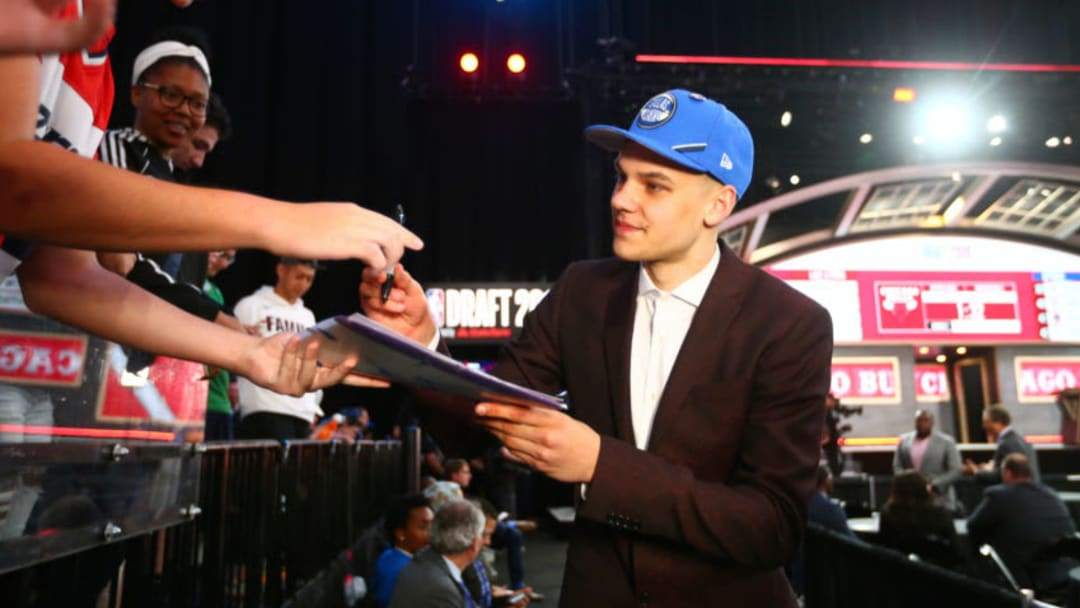 BROOKLYN, NY - JUNE 20: Deividas Sirvydis signs autographs after being selected thirty-seventh overall by the Dallas Mavericks during the 2019 NBA Draft on June 20, 2019 at the Barclays Center in Brooklyn, New York. NOTE TO USER: User expressly acknowledges and agrees that, by downloading and/or using this photograph, user is consenting to the terms and conditions of the Getty Images License Agreement. Mandatory Copyright Notice: Copyright 2019 NBAE (Photo by Elizabeth Shrier/NBAE via Getty Images)