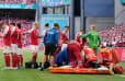 Christian Eriksen collapses on the pitch but signal he'll be okay