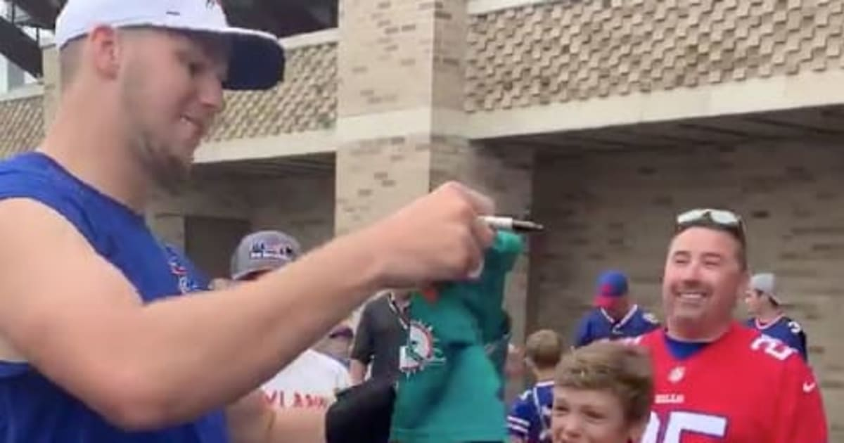 edad760a VIDEO: Josh Allen Forces Kid in Dolphins Jersey to Ditch it for ...