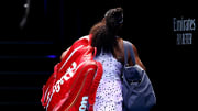 Serena Williams walks off the court after losing at the Australian Open.