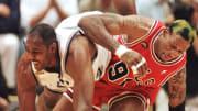 Dennis Rodman and Karl Malone wrestling.