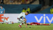 Cristiano Ronaldo looks dejected as Belgium celebrate