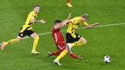 Joshua Kimmich damaged his meniscus after challenging Borussia Dortmund's Erling Braut Haaland
