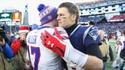 Josh Allen and Tom Brady hugging.