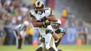 LOS ANGELES, CA - NOVEMBER 06:  Lance Kendricks #88 of the Los Angeles Rams is tackled by Kurt Coleman #20 of the Carolina Panthers during the fourth quarter of the game at the Los Angeles Coliseum on November 6, 2016 in Los Angeles, California.  (Photo by Harry How/Getty Images)