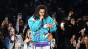 J. Cole performing at NBA All-Star Weekend.