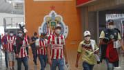 Aficionados de Chivas y América.