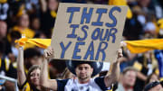 Cowboys fan makes bold prediction on cardboard.