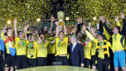 Dortmund's players celebrate with the tr