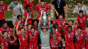 Manuel Neuer hoists aloft the Champions League trophy after an imperious individual display in the final