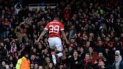 A young Rashford celebrates in front of a rabid Old Trafford