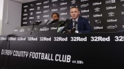 DC United midfielder and former England captain Wayne Rooney (R), alongside Derby County's Dutch manager Phillip Cocu, speaks during a press conference at Pride Park Stadium in Derby on August 6, 2019 after Rooney agreed a deal to become a player-coach. - Former England captain Wayne Rooney is to leave Washington-based DC United after agreeing a deal to become player-coach of English Championship side Derby County. The 33-year-old -- the record goalscorer for both his country and Manchester United -- signed an 18-month contract with the second-tier side, who under Rooney's former England teammate Frank Lampard reached the play-off final last season. (Photo by DARREN STAPLES / AFP)        (Photo credit should read DARREN STAPLES/AFP/Getty Images)