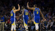 Stephen Curry high-fives Andre Iguodala