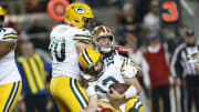 Aaron Rodgers gets sacked
