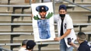 A Yankees fan holds an anti-Jose Altuve sign.