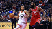 Toronto Raptors wing Norman Powell driving against Houston Rockets guard James Harden
