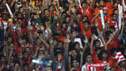 Indonesian fans cheer at the Gelora Bung
