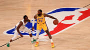 LeBron James guarded by a member of the Los Angeles Clippers.