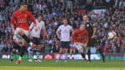 Cristiano Ronaldo scores a penalty for Manchester United against Tottenham Hotspur