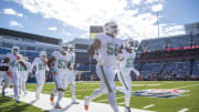 Miami Dolphins defense running out on the field for warmups against the Buffalo Bills