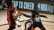 Giannis Antetokounmpo surrounded by Heat