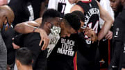 Giannis Antetokounmpo helped off the court during game 4.