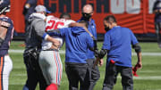 Saquon Barkley helped off the field after suffering a knee injury, New York Giants v Chicago Bears