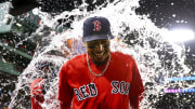 BOSTON, MA - JULY 26:  Mookie Betts #50 of the Boston Red Sox is showered in Gatorade after the Boston Red Sox defeated the New York Yankees 10-5 at Fenway Park on July 26, 2019 in Boston, Massachusetts.  (Photo by Adam Glanzman/Getty Images)
