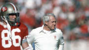 Former San Francisco 49ers coach Bill Walsh on the sidelines during a game.