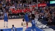 Trae Young pulled of an incredible circus shot from behind the backboard against the Mavericks
