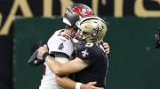 Drew Brees hugs Tom Brady.