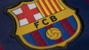 The FC Barcelona and Manchester City Club Badges