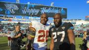 Washington Redskins RB Adrian Peterson with Jacksonville Jaguars RB Leonard Fournette