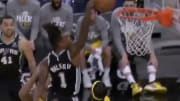 San Antonio Spurs guard Lonnie Walker posterizes two Indiana Pacers players.