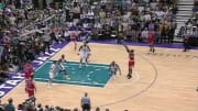 Michael Jordan shoots over Bryon Russell in Game 6 of the 1998 NBA Finals