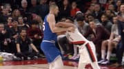 Portland Trail Blazers guard CJ McCollum pushes Kings big man Alex Len