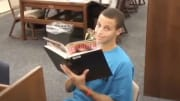 Stephen Curry reading Seventeen in the Davidson library.