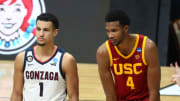 Mar 30, 2021; Indianapolis, IN, USA; Gonzaga Bulldogs guard Jalen Suggs (1) and Southern California Trojans forward Evan Mobley (4) during the Elite Eight of the 2021 NCAA Tournament at Lucas Oil Stadium. Mandatory Credit: Mark J. Rebilas-USA TODAY Sports