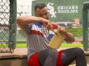 Nelson Cruz builds a cardboard glove like the one he used to make as a kid in the Dominican Republic.