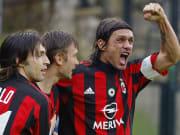 AC Milan's captain Paolo Maldini (R) jub