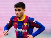 Pedri saat bermain dengan Barcelona