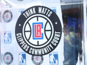 L.A. Clippers Open New Clippers Community Courts In Watts With Community Activist Stix