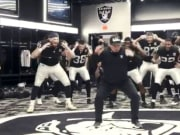 Las Vegas head coach Jon Gruden leads his team in an awesome locker room celebration after defeating the New Orleans Saints on Monday Night Football.