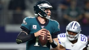 Carson Wentz drops back to pass in a game against the Dallas Cowboys.