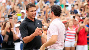 ATLANTA, GEORGIA - AUGUST 25: Brooks Koepka of the United States congratulates Rory McIlroy of Northern Ireland on the 18th green after McIlroy won the FedEx Cup and Tour Championship during the final round of the TOUR Championship at East Lake Golf Club on August 25, 2019 in Atlanta, Georgia. (Photo by Cliff Hawkins/Getty Images)