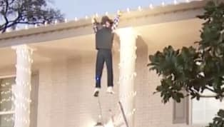 Man Tries to Rescue Guy Hanging From Roof - Who Turns Out to Be 'Clark Griswold' Dummy.