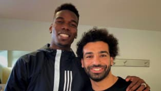 t it Footballfans were left amazed when a photo emerged ofPaul Pogbawith his arm around Liverpool'sMohamed Salah...on transfer deadline day of all days....