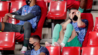 ench In the latest episode of Gareth Bale Watch, the Wales winger was spotted on the bench during Monday night's clash with Granada fashioning a makeshift pair...